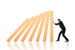 Stop the domino effect Stock Photography