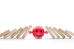 Stop the domino effect. Concept of stop the domino effect Stock Photos