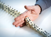 Stop Domino Effect - Hand Prevents Stock Images