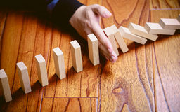Stop The Domino Effect Royalty Free Stock Image