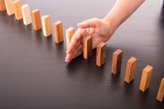 Stop domino risk effect. Royalty Free Stock Photography