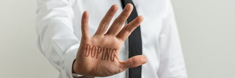 Stop doping sign. Male hand making a stop sign with a Doping sign over the palm stock image