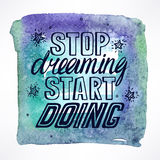 Stop dreaming start doing. Hand-drawn quote on watercolor background Stock Image