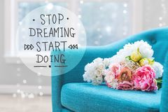Stop Dreaming Start Doing message with flower bouquets with chai Royalty Free Stock Photos