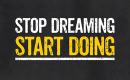 Stop dreaming Start Doing. Sign with the text Stop dreaming Start Doing Royalty Free Stock Photos