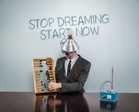 Stop dreaming start  now text on blackboard with businessman Royalty Free Stock Images