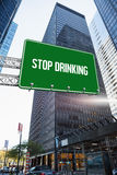 Stop drinking against skyscraper in city Stock Photo