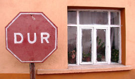 Stop (Dur) Sign in Bursa, Turkey. Sits next to quiet window sill Royalty Free Stock Image