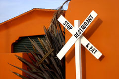 Stop and Eat. A railroad crossing sign doubles as a restaurant sign Royalty Free Stock Image