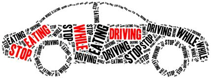 Stop eating while driving. Stock Image