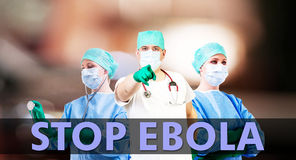 Stop Ebola medical background. With male and female doctor Royalty Free Stock Images
