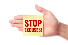Stop Excuses. Hand with Stop Excuses note is isolated on white background Stock Photos