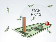Stop Fixing concept with stumps and ball. Stop Fixing concept with red shiny ball and wicket stumps on a doller note Royalty Free Stock Image