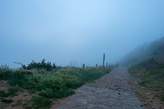 The stop of forgiveness with fog on the road to Santiago. Spain royalty free stock images