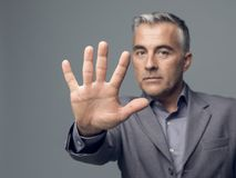 Stop gesture. Businessman doing a stop gesture with his hand, rejection and denial concept Royalty Free Stock Photo