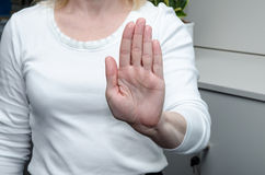 Stop gesture. Hand with stop gesture on white background Royalty Free Stock Photo
