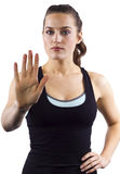 Stop Gesture. Young female fitness trainer with a stop gesture Royalty Free Stock Photos