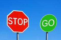 Stop & Go. Stop and Go signs against a blue sky stock image