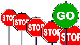 Stop and Go. Severa; octagonal stop signs and one large geen go sign isolated over a white background Royalty Free Stock Photography
