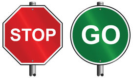 Stop and go signs Stock Photo