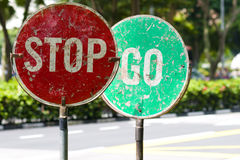 Stop and go traffic road signs. Two road signs side by side that contradicts each other Stock Photo