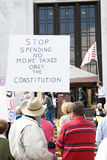 Stop government spending protest sign. A man at a Tea Party march on April 15, 2010 in Salem, Oregon holding a protest sign against government spending and royalty free stock photography
