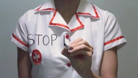 STOP HAIR LOSS, Female doctor writing on transparent screen stock video
