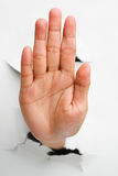 Stop hand sign. Came from cracked wall - one of the breakthrough series royalty free stock images