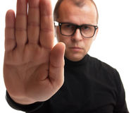 Stop hand sign. Man in black dolce vita in rejective position isolated on white Royalty Free Stock Image