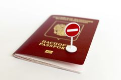 Stop illegal migration concept, Russian passport and stop sign close up. stock photos