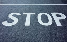 Stop inscription on a road Royalty Free Stock Photography