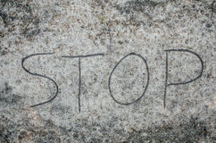 Stop inscription on sand Stock Image