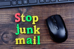 Stop junk mail words on table Stock Photography