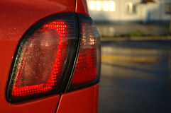 Stop light. Back light of red car on blured background royalty free stock photography