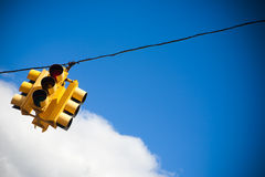 Stop light. Stoplight on wire against blue sky royalty free stock images