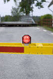 Stop light at crossing. A red flashing light on a road barrier Stock Photography