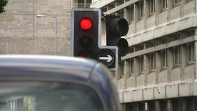 A stop light shot. A medium shot of a stop light in city stock footage
