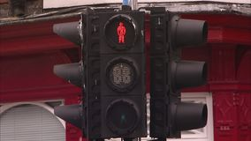 A stop light shot. A medium shot of a stop light in city stock video footage
