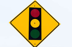 Stop light sign. Yellow stop light sign with yellow orange and green lights stock photos