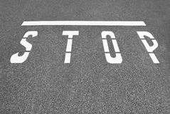 Stop Line. This STOP is painted on the asphalt to let drivers know where to stop Stock Photo