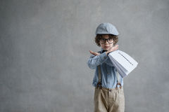 Stop. Little director with screenplay indoors Stock Photos