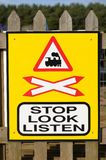 Stop, Look, Listen Sign at a Railway Crossing Royalty Free Stock Image