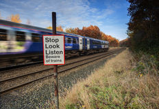 Stop look listen warning at level crossing Royalty Free Stock Image