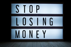 Stop losing money. `Stop losing money` text in lightbox Royalty Free Stock Images