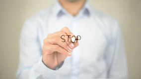 Stop, Man Writing on Transparent Screen. High quality Stock Image