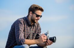 Stop the moment. capture adventure. journalist. macho man with camera. photographer in glasses. travel with camera. male