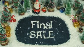 Stop motion animation of Final Sale. Stop motion gift box Santa Claus decoration on snow for christmas and Happy New Year background Stock Photo