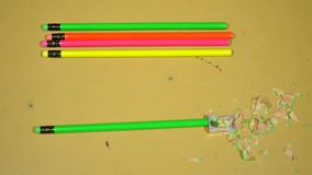 Stop motion animation of sharpening one of the pencils stock footage