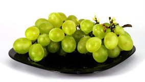 Stop motion of Bunch of green grapes on black plate stock video footage