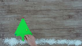 Stop motion of christmas tree and snowflakes stock video